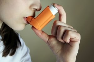 Girl breathing asthmatic inhaler