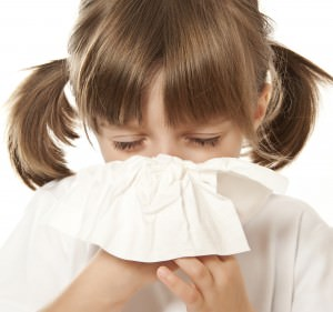 ill little girl with handkerchief